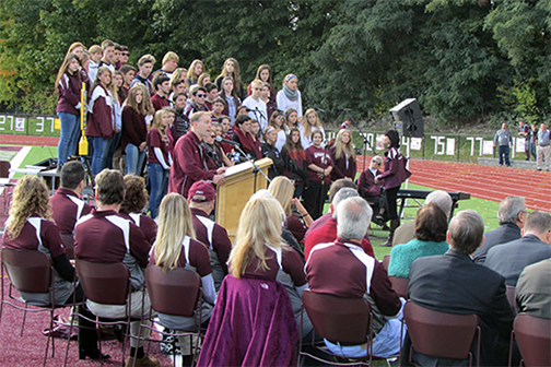students singing on centennial field
