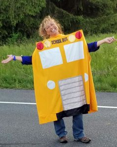 adult wearing a school bus costume