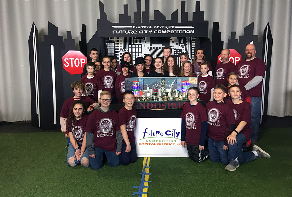 Future cities team wearing maroon shirts